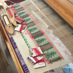 Image of the piece titled 3 Heart Tree being woven on the drawloom.